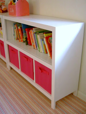 painted free standing bookshelves with storage bins