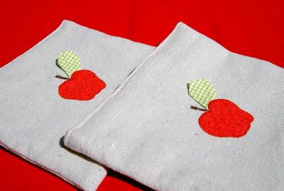 apple applique at center front