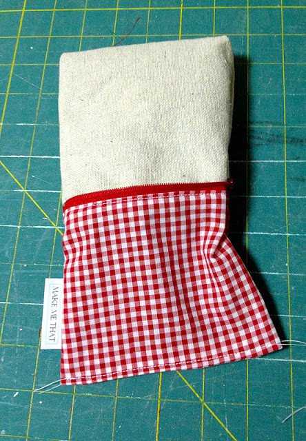 red gingham lining of zippered pouch