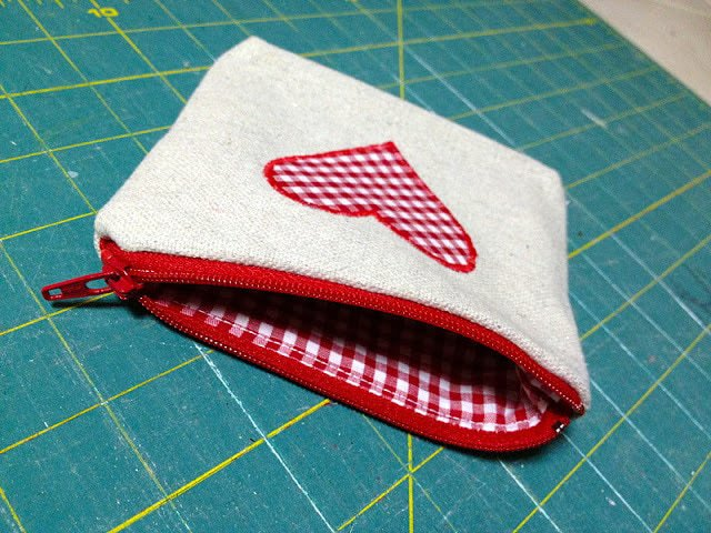 open zippered side of canvas pouch