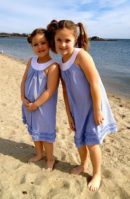 young girls on beach in seersucker dresses