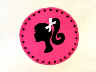 barbie silhouette sewn onto canvas pouches