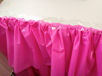 ruffled table base cover using plastic tablecloth and packing tape
