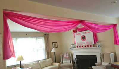 diy wall swags for party using plastic tablecloth