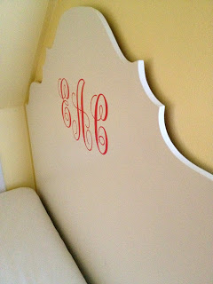 curby headboard hanging on wall