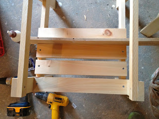scrap wood as a spacer between slats