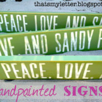 handpainted sandy feet sign