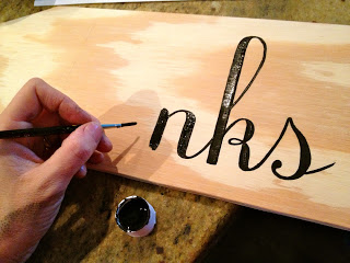 handpainting lettering onto wood