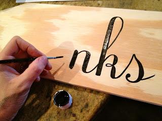 handpainting lettering onto wood