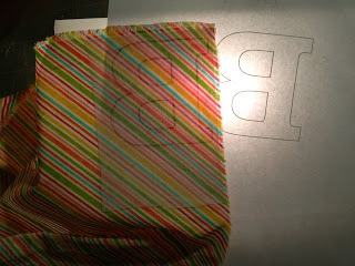 tracing letter shape on light box
