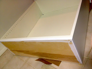 painted plywood base on kitchen cabinet