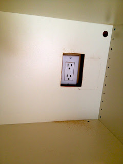 cut out hole in backing for outlet access