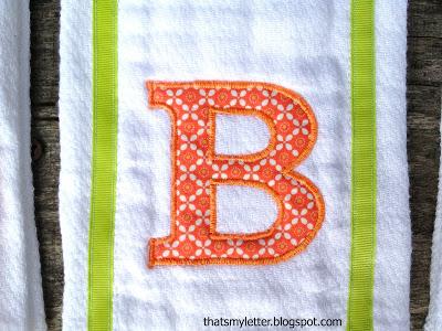 appliquéd letter on cloth diaper