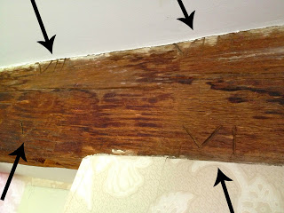 roman numerals carved into wood beams