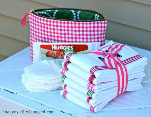 quilted zipper pouch and monogrammed burp cloths