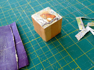 sanding off excess paper to smooth edge