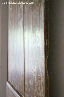 primitive farmhouse door sealed with poly