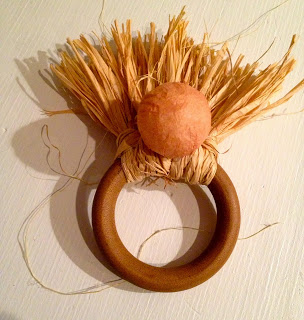hot glue wrapped styrofoam ball onto raffia