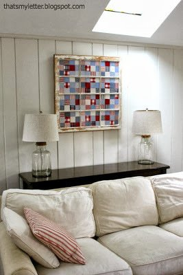 old window repurposed to frame quilt pieces