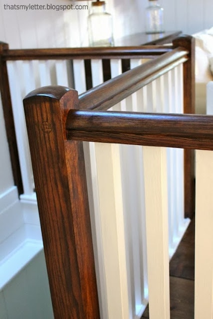 stained railing with white balusters