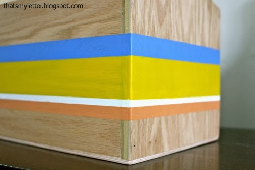 painted stripes on side of wood rug