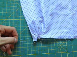 pulling on thread to make gather