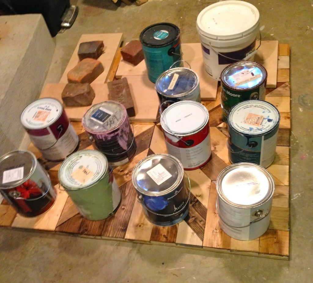 heavy paint cans to weigh down wood pieces while drying