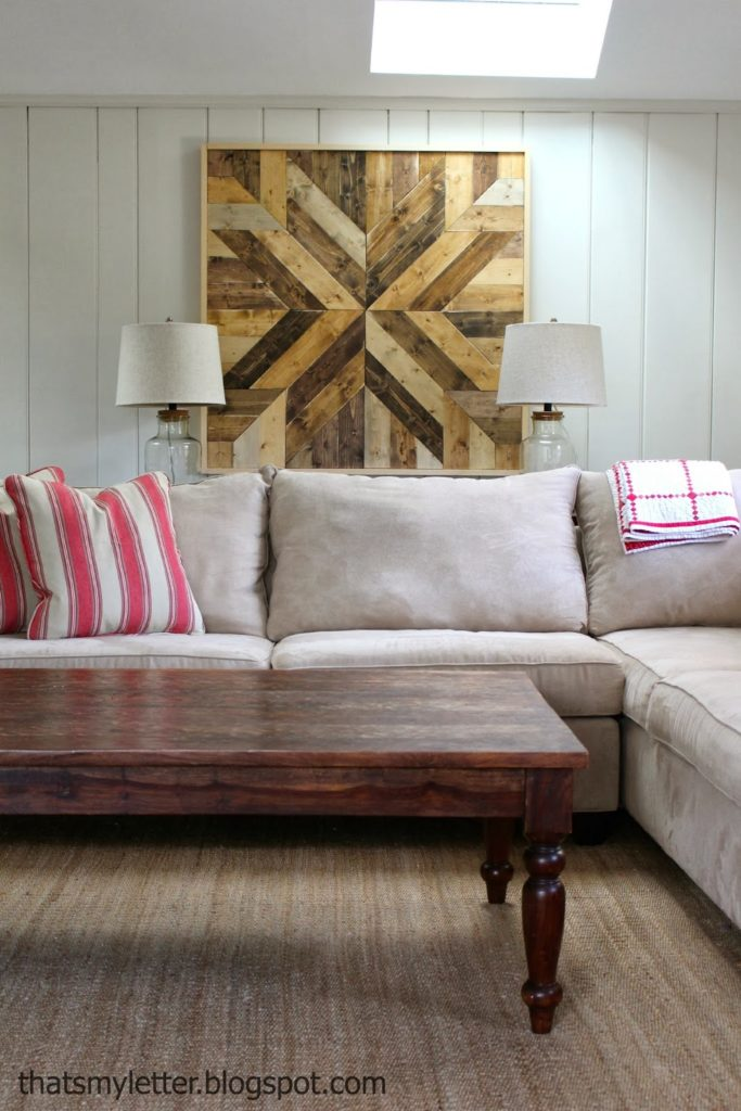 family room sofa with wood wall quilt