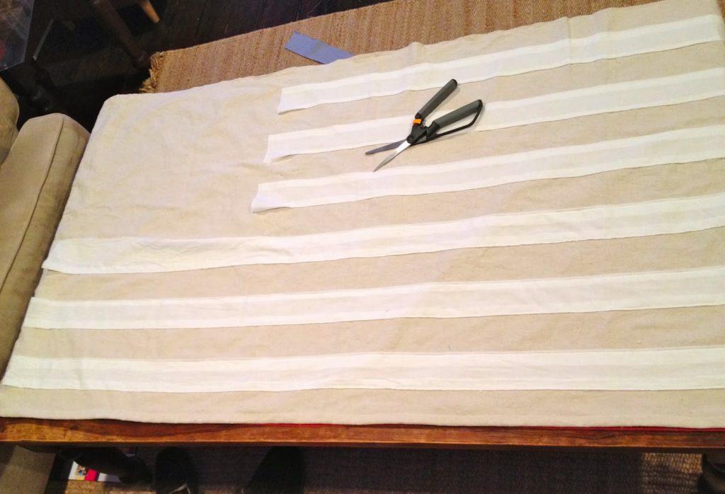 top stitch white stripes to drop cloth flag