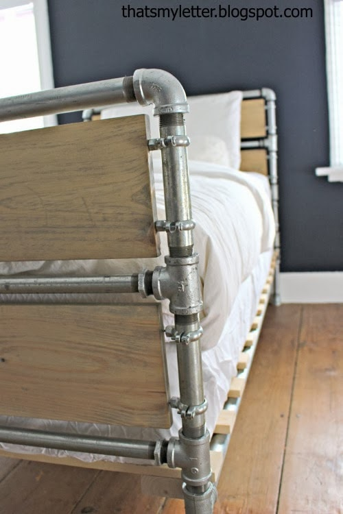 steel pipe and wood slats bed