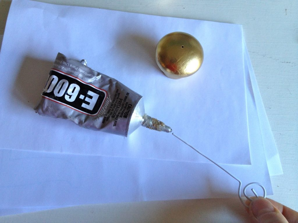 glue paper clip into wood knob