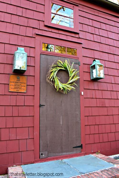 farmhouse door with spring wreath