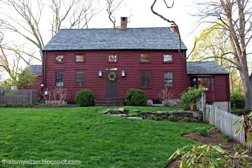 saltbox farmhouse exterior at springtime