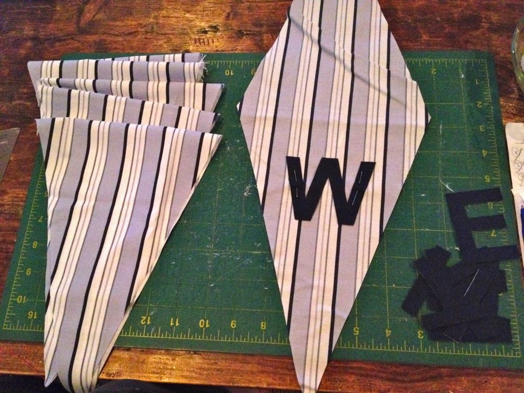 pin letters onto triangle front