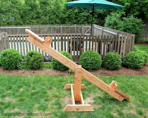 wood see saw in backyard