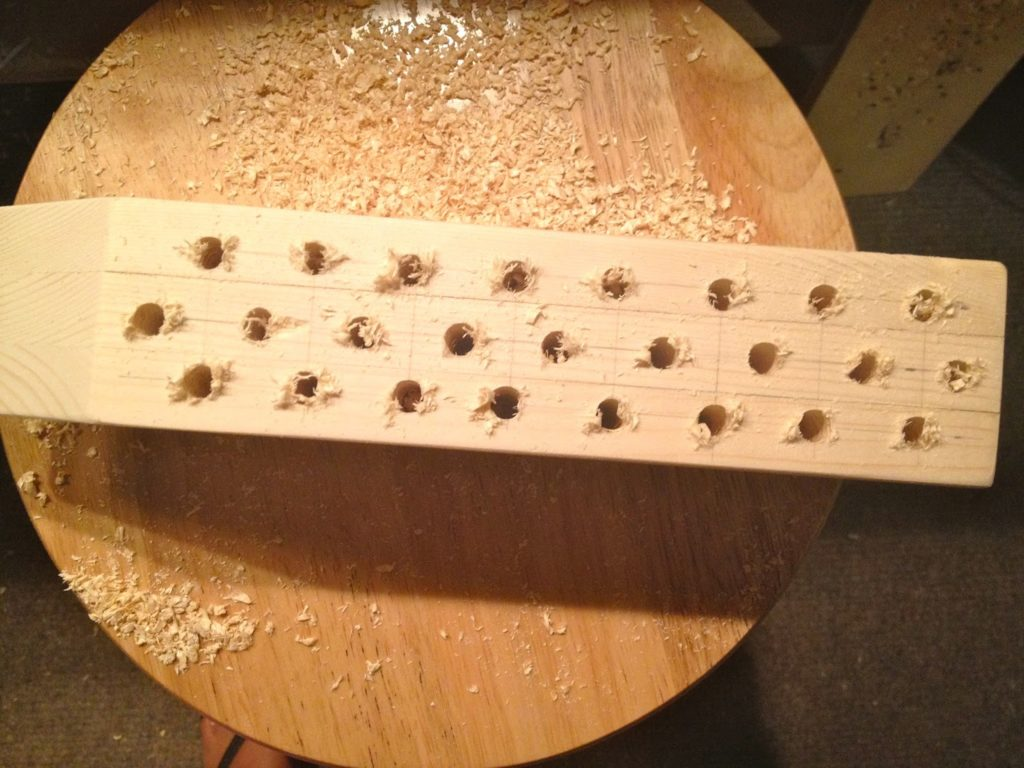 holes for pencils in wood