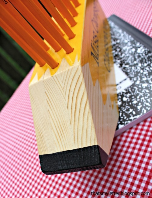 large pencil made from pine boards