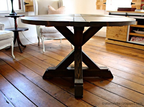 side view of x base pedestal table