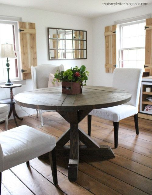 farmhouse living room with interior shutters and x base table