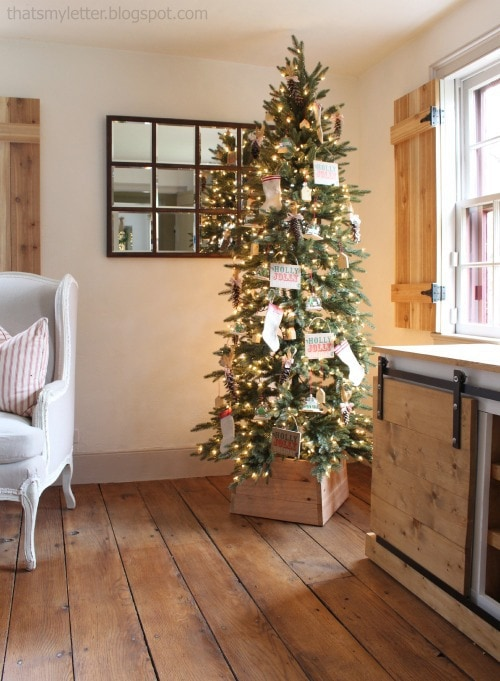 pre-lit slim Christmas tree with wood collar