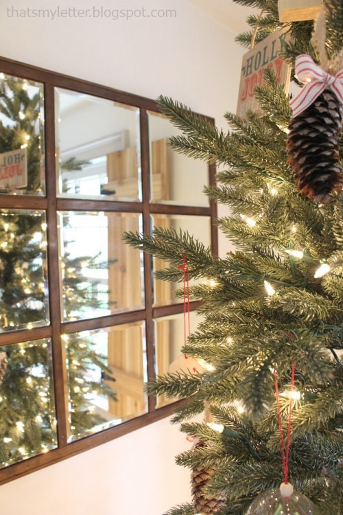 mirror behind Christmas tree adds reflection