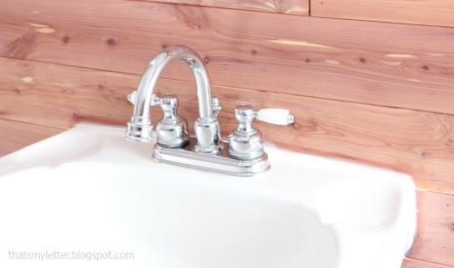 bathroom makeover cedar planked walls white sink