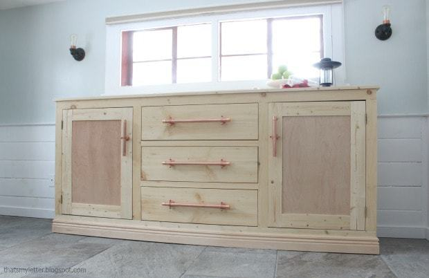 diy long sideboard cabinet in front of windows