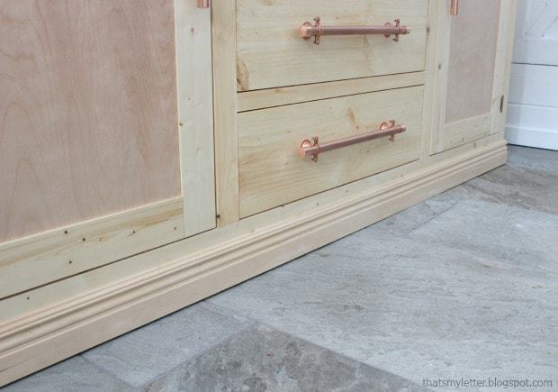 baseboard trim on sideboard