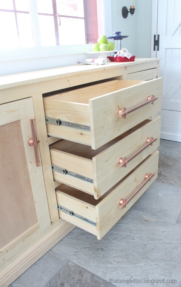 three deep drawers on sideboard