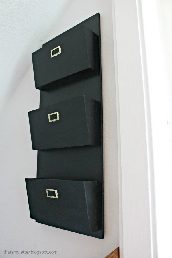 mail sorter on wall