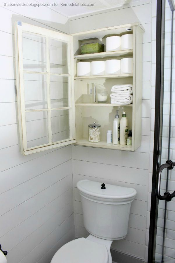 interior of bathroom storage cabinet above toilet