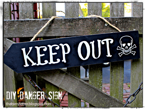 diy keep out skull and crossbones arrow sign