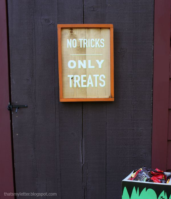 no tricks only treats sign on exterior door