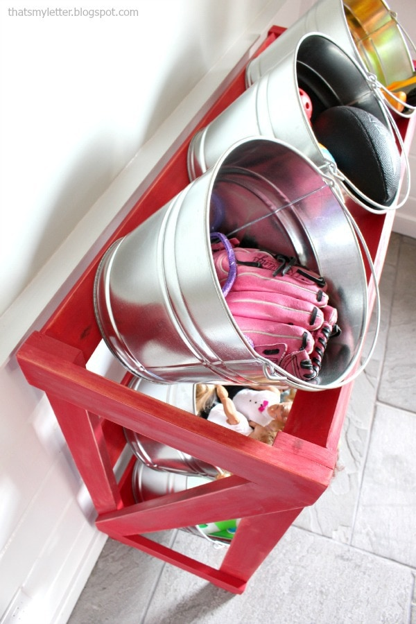 slanted shelving system with buckets